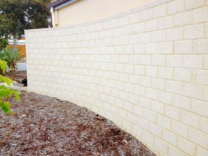 freestanding limestone block wall