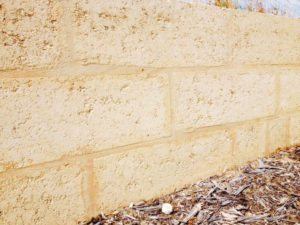 reconstituted limestone block wall