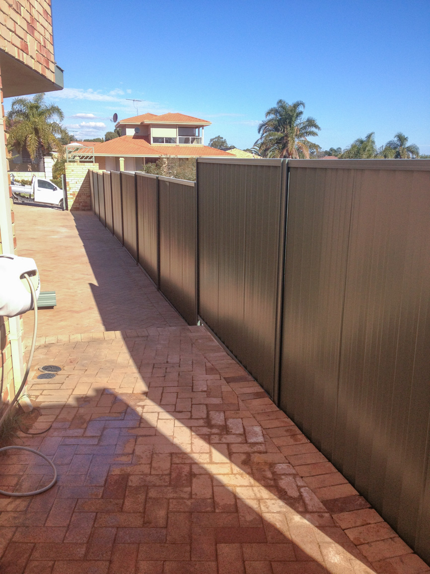 panel and post retaining with colorbond fence
