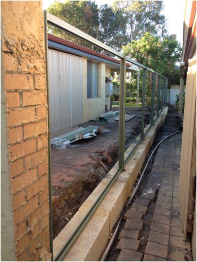 colorbond fencing installed onto limestone retaining blocks