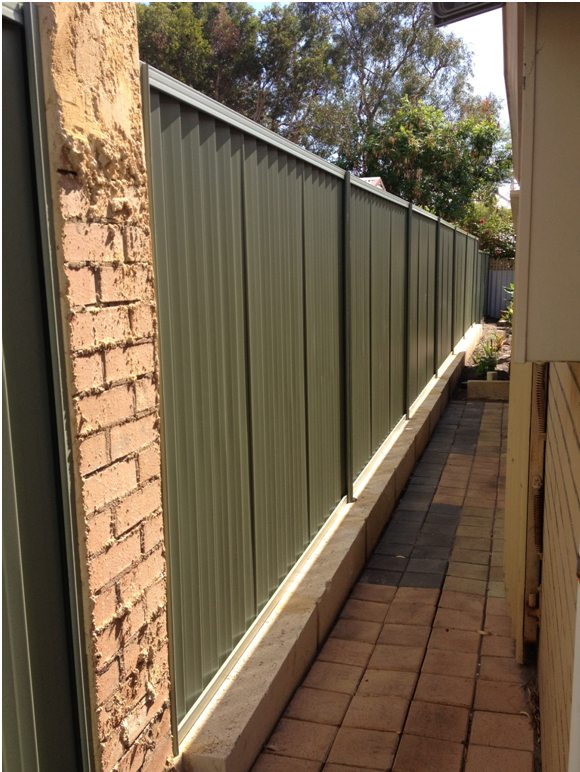 colorbond fence and limestone block retaining Perth