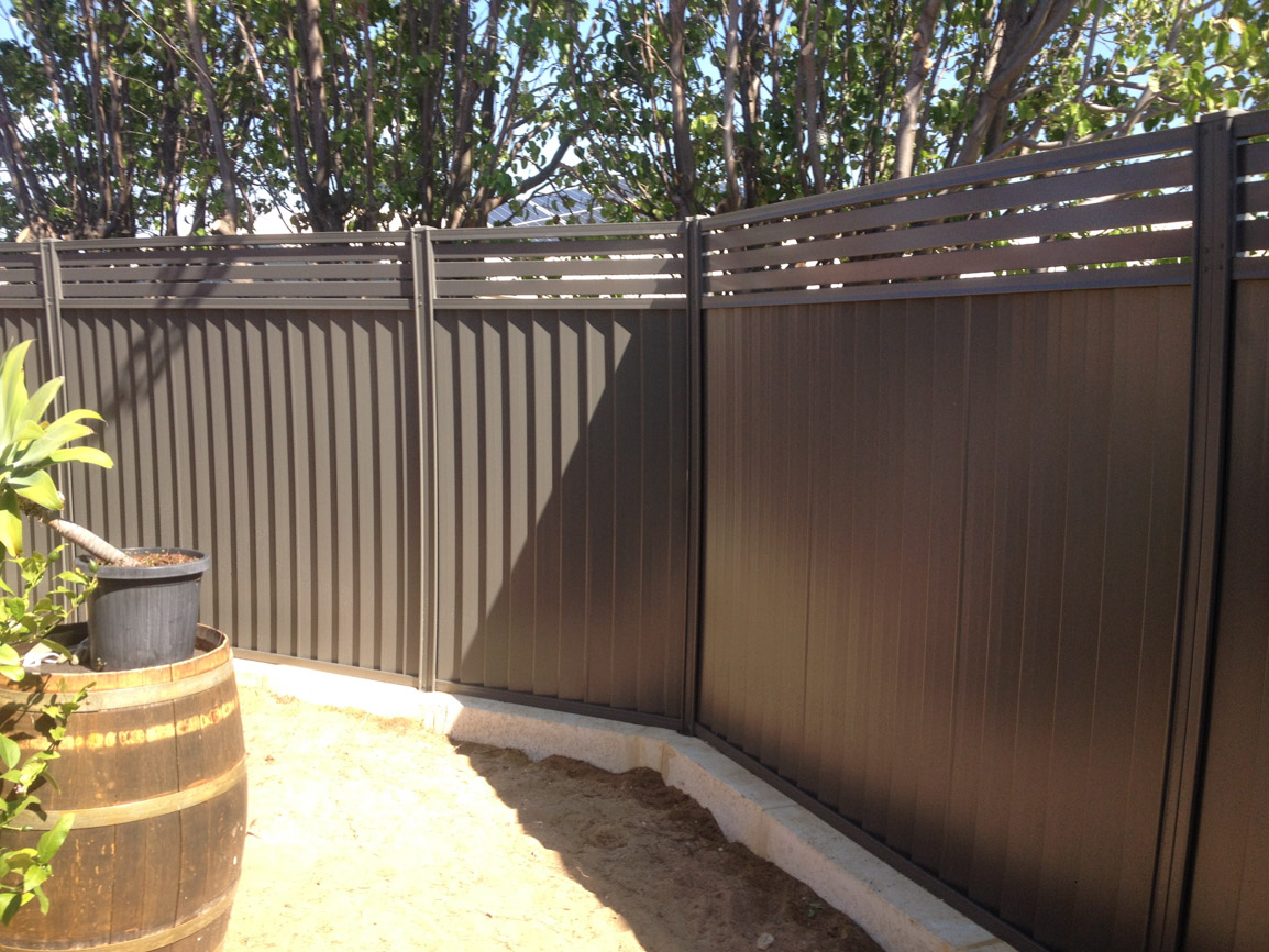 Limestone wall with colorbond fence aluminium slats