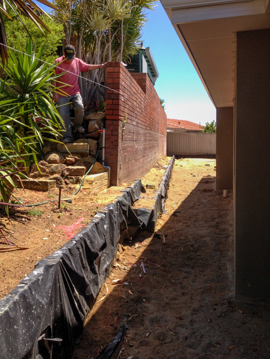 retaining wall with colorbond fence on top