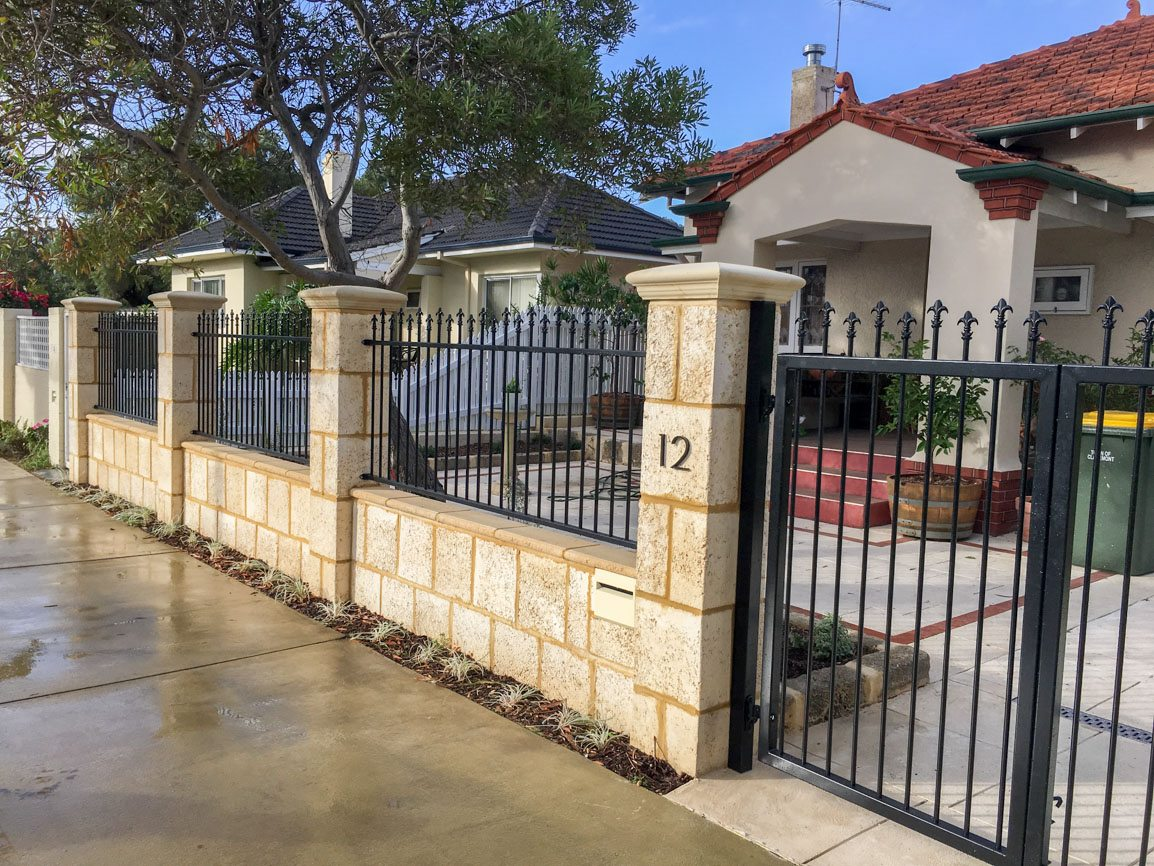 Reconstituted limestone block wall with infills Swanbourne built in letterbox