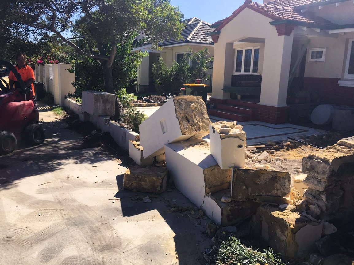 Reconstituted limestone block wall with infills Swanbourne before picture demolition