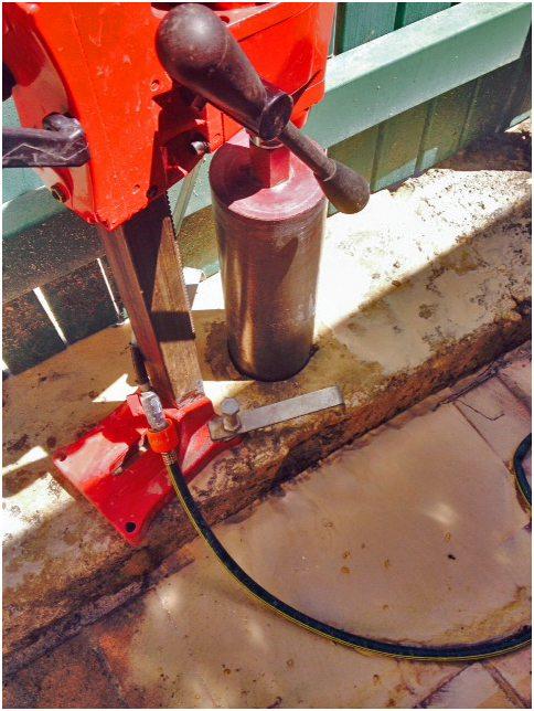 Core drilling natural limestone blocks for colorbond fence Perth