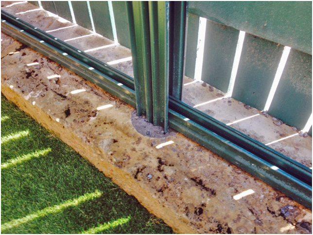 Colourbond fencing installation in limestone block retaining