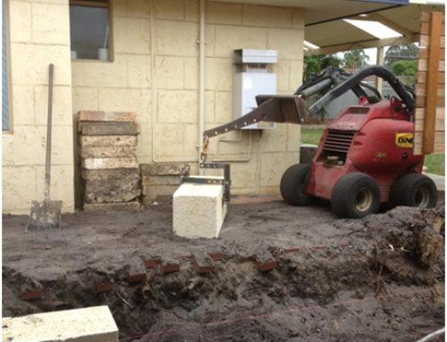 Dingo minimal access excavation/ earthmover machine and operator.