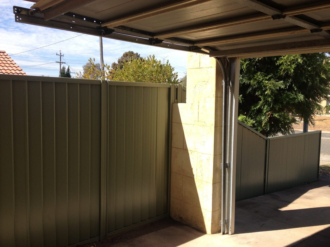 Colorbond fence and limestone block wall