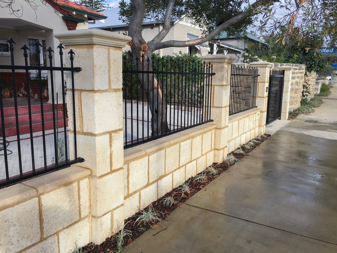 Reconstituted limestone block wall with infills Swanbourne