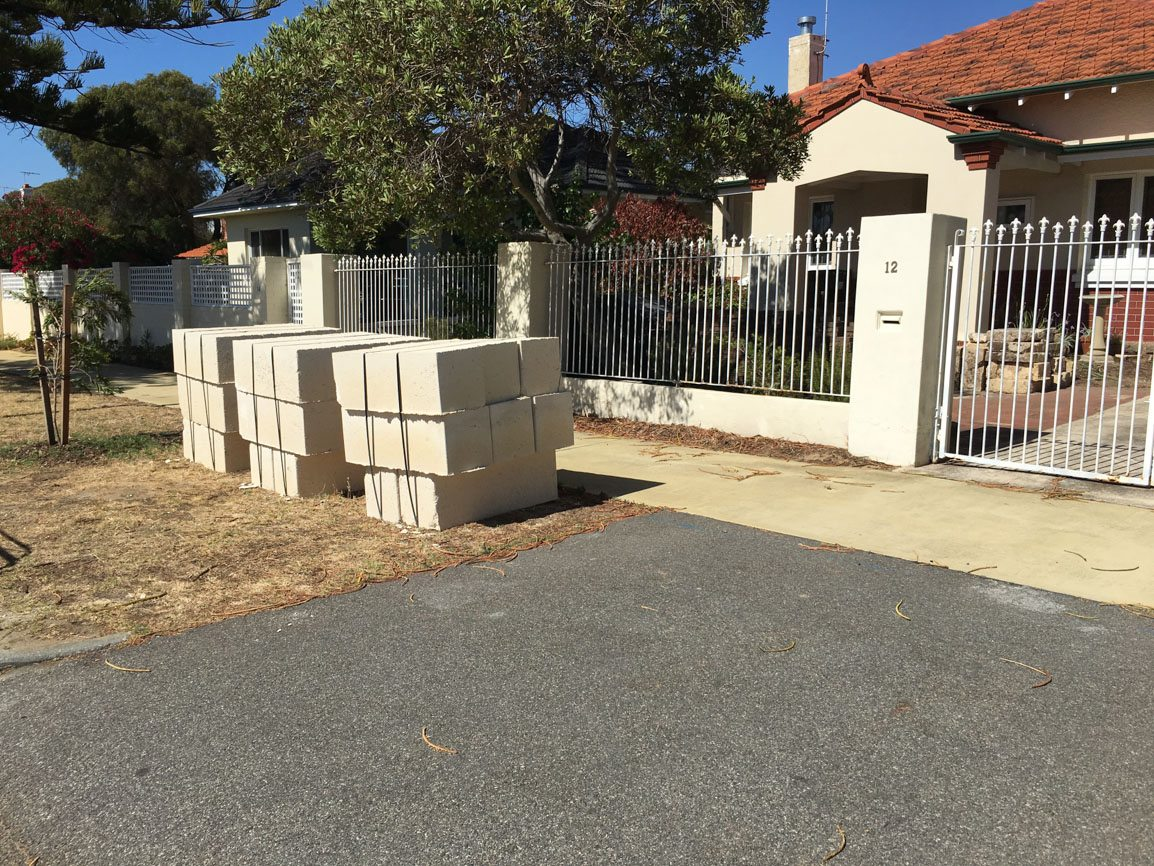 Reconstituted limestone block wall with infills Swanbourne before picture limestone pavers