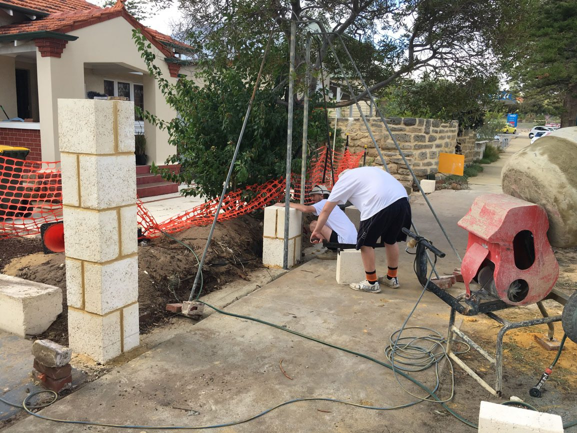 Reconstituted limestone block wall with infills Swanbourne before picture brick layer contractor