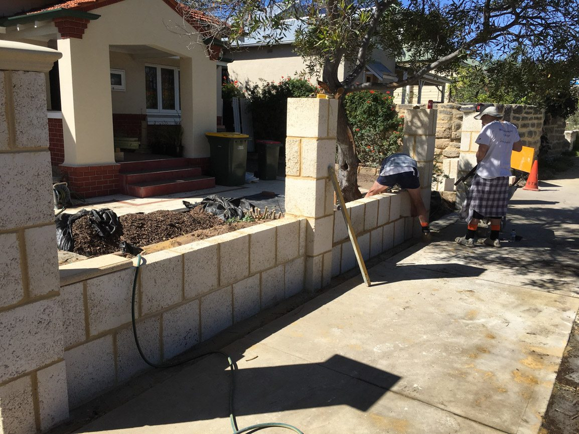 Reconstituted limestone block wall with infills Swanbourne before picture